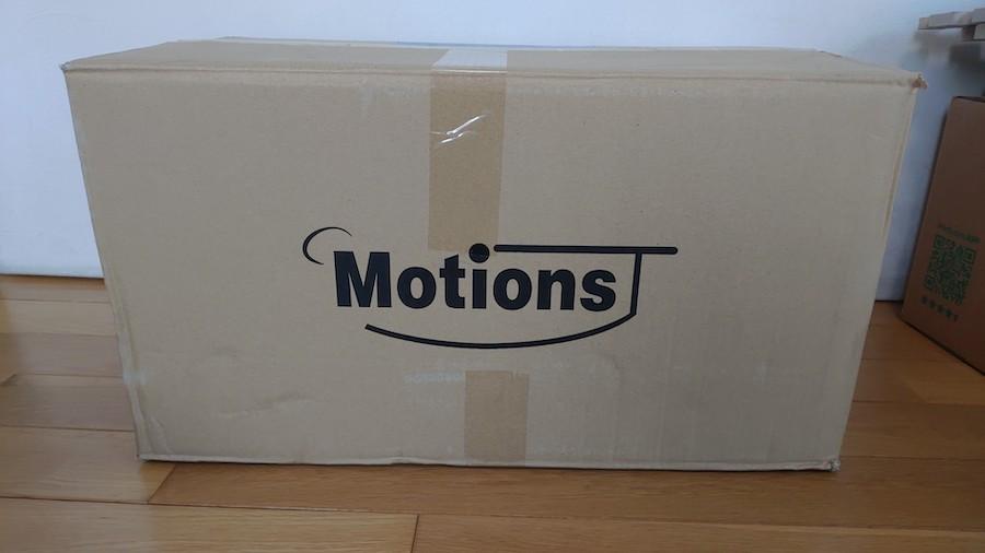motionsダンベルが梱包されたダンボール箱